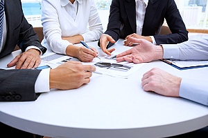 business investors negotiating software contracts