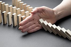 Hand stopping falling blocks for crisis prearedness