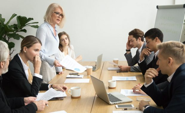 a team in a crisis management meeting preparing for uncertainty during a pandemic