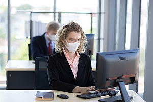 an employee wearing a mask to prevent a virus breakout
