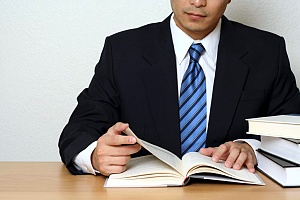 a business person reading a recommended book for business strategies