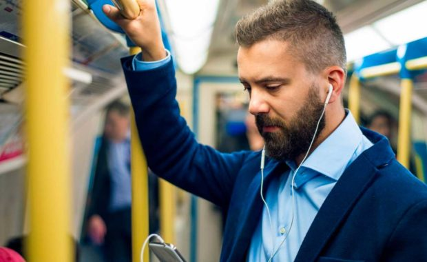 a-person-listening-to-podcasts-on-the-train
