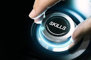 a hand on a knob showing that you have to boost your business skills for careers in it