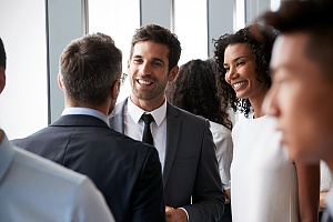 people networking in a business environment for careers in it