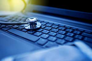 stethoscope on a laptop depicting hardware review as part of an IT due diligence checklist