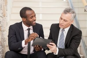 Two business executives engaged in IT management consulting