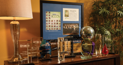 Hartman's Various awards on a shelf