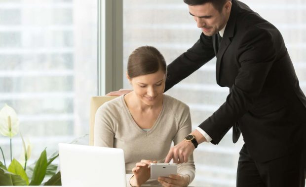coworkers-going-through-the-benefits-of-a-proper-software-evaluation
