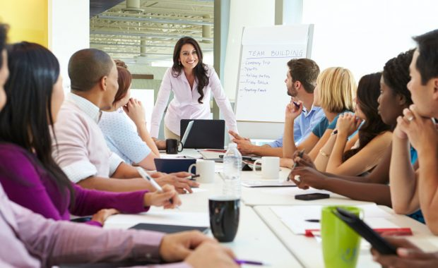 change management communication taking place during a business meeting