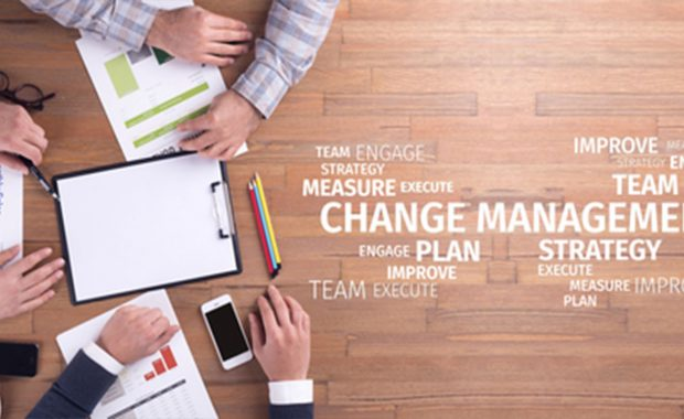 Change management word with people discussing