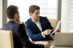 Man identifying risks to colleague