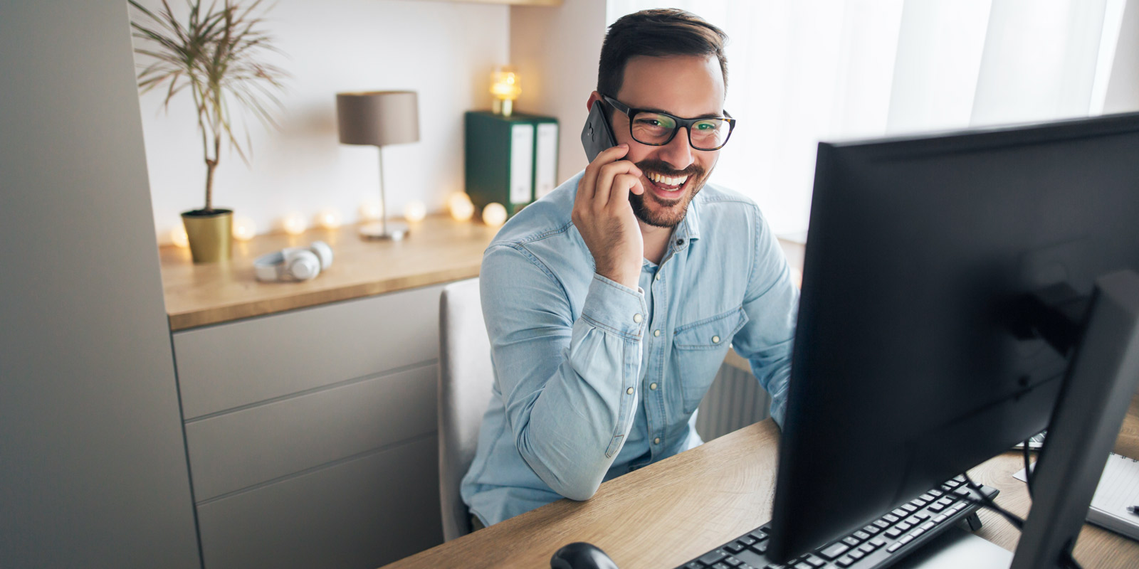 Man on phone working from home