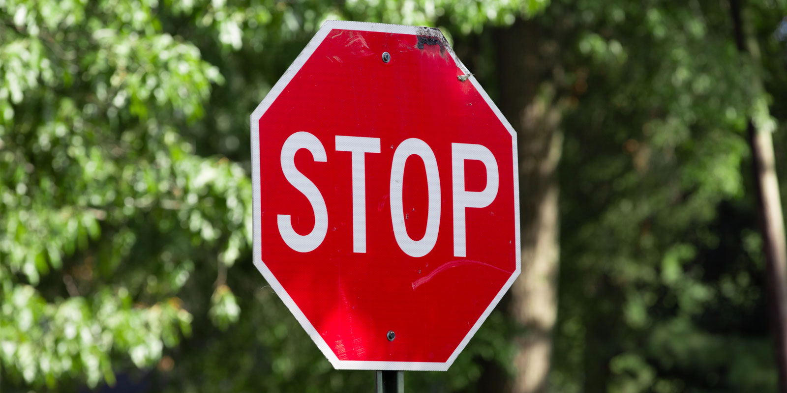 a stop sign warning individuals to research virtual event technology before purchasing it