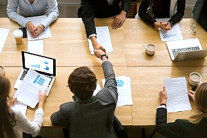 employees at a business meeting to discuss vendor selection