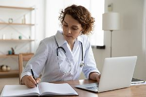 A female doctor providing medical consultation using a Telehealth Software