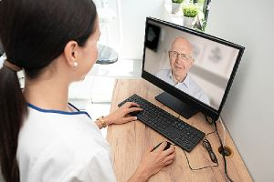 A doctor providing consultation to a patient. A Telehealth for Patients concept image
