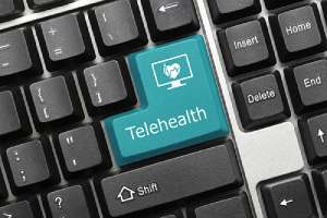 Close-up view on conceptual keyboard that has Telehealth consulting key