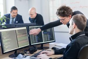 people looking at desktop screen