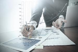 Businessman with business graph information. M&A integration may require bank leaders to develop new business processes