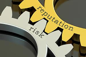 Reputation risk concept on the gearwheels. Reputational damage caused by cyberattacks can be devastating