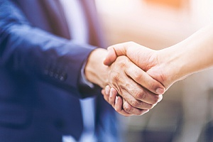 a handshake between a new CIO and the owner of a company