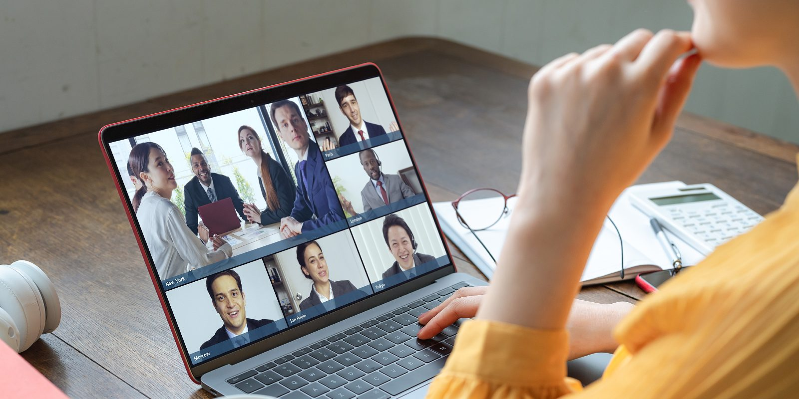 An employee attending team meeting. There are cybersecurity risks associated with teleworking