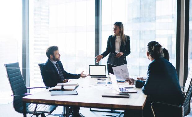 a team of executives considering interim executive placement services