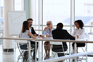 a team of executives who are discussing business processes with an outsourced CIO
