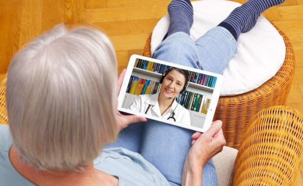 telehealth cybersecurity requirements- old woman with tablet during an online consultation with doctor