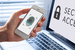 person using fingerprint scanning on mobile phone at telehealth cybersecurity requirements