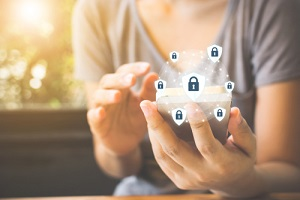 woman hand using smartphone and icon key on shield on telehealth cybersecurity requirements