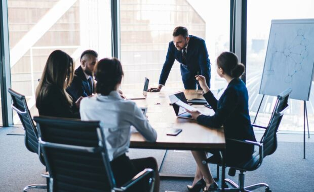 business executives defining the duties and responsibilities for their new interim CIO