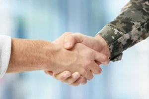 civilian and army officer shaking hands
