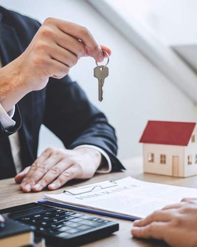 a loan association giving a key to a homeowner